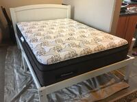 As new double bed with wood frame