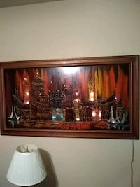 brown wooden framed painting...electric lights...  Las Vegas, 89122