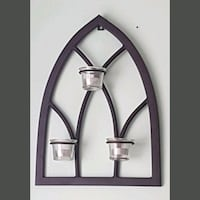 Wrought iron tealight arch. Whitby, L1N 8X2