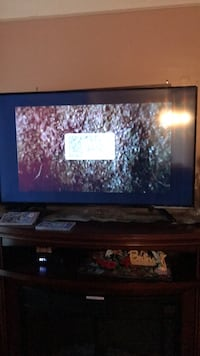 Black flat screen tv with remote Redford, 48239