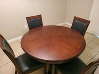 Round table with 4 chairs like new  Missouri City