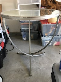 clear glass table top with gray frame
