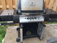 Black and silver Broil King gas grill