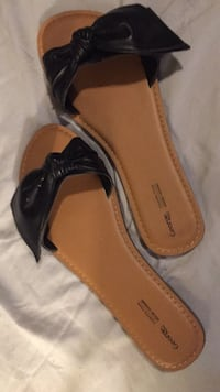 pair of black leather sandals London, N5W 3E4