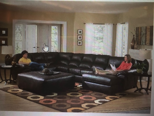 Black leather sectional sofa with throw pillows