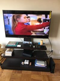 black flat screen TV with black wooden TV stand Woodbridge, 22192