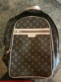 brown monogrammed Louis Vuitton leather backpack Edmonton, T6R 2S3