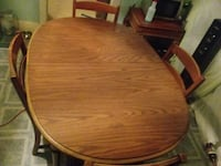 round brown wooden table with four chairs dining set Decatur, 62526