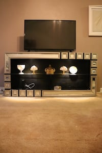 Mirrored TV console with lighting. Price is firm. Greenbelt, 20770