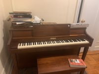 brown wooden upright piano with chair New York, 10034