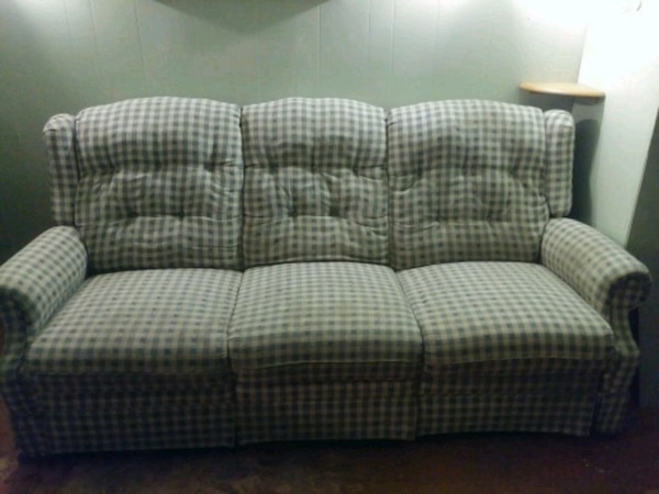 Blue and White Reclining Sofa and Loveseat