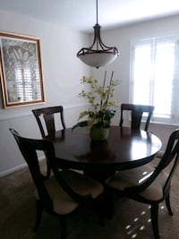 round brown wooden table with four chairs dining set Washington, 20004
