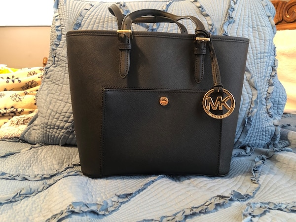 35cba5c9184d9a Used black Michael Kors leather tote bag for sale in Jacksonville ...