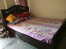 Queen size bed woth drawers along with new mattres