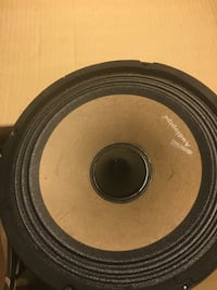 round black and gray subwoofer 77 km