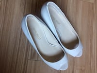 Nine West off-white pumps size 5 Burnaby, V5H 4L4