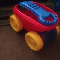 used children 39 s red blue and yellow toy wagon for sale. Black Bedroom Furniture Sets. Home Design Ideas