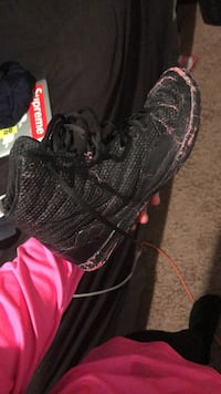 unpaired black and pink high-top sneaker