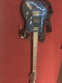black and brown electric guitar null