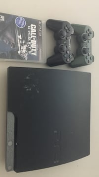 black Sony PS3 slim console with controller and game cases Toronto, M9R 4A6