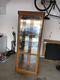 Corner curio cabinet. Lights up Woodbridge, 22192
