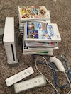 white Wii game console with game controllers and 20+ games