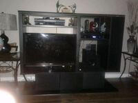 black flat screen TV with brown wooden entertainment center Edmonton, T5P 1Y1