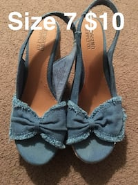 pair of gray-and-black sandals 612 mi