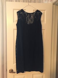 Woman's nave blue lace dress. Size 16 worn once asking for $100 or best offer!