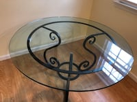 Indoor or outdoor patio table thick glass and very sturdy excellent condition Morristown, 07960