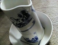 white and blue floral ceramic pitcher with wash ba