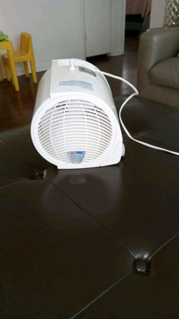 white and blue portable fan