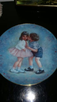 boy and gray print in round commemorative plate
