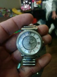 round silver analog watch with silver link bracelet Murfreesboro, 37129
