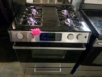 GE slide-In gas stove stainless Steel working perfectly four months wa Baltimore, 21223