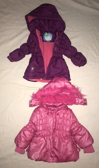 two purple and pink zip-up hoodies