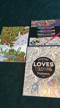 three assorted-color books