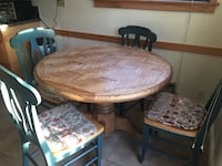 Solid Oak pedestal table and four chairs