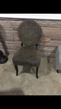 gray fabric padded dining chair