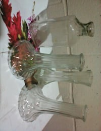 three clear cut glass vases and clear glass bottle New Jersey, 08889