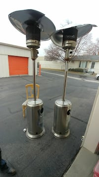 two stainless steel patio heaters