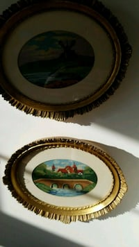 two oval brown painting frames