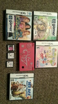 four Nintendo DS game cartridges
