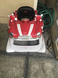 toddler's red and white combi walker