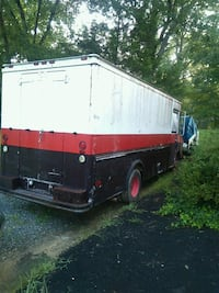 red and white camper trailer 65 km