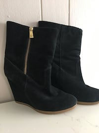 pair of black suede side-zip booties null