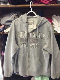 gray and white The North Face zip-up hoodie