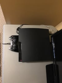 Black sony ps3 slim console with controller Surrey, V3S 1B9