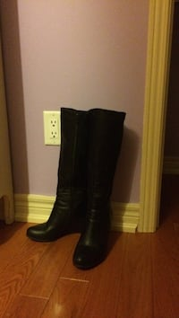 pair of black leather knee-high boots Bolton, L7E 1J5