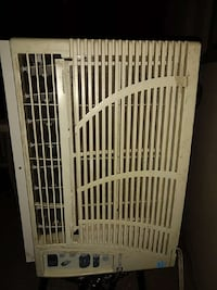 beige window type AC unit Welland, L3C